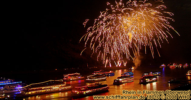 Boat cruise Rhine in Flames near Oberwesel on the Rhine River